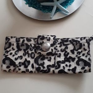 Icing black and white animal print clutch